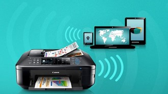 A picture of a printer receiving wireless signal from a phone, a tablet, and a laptop.
